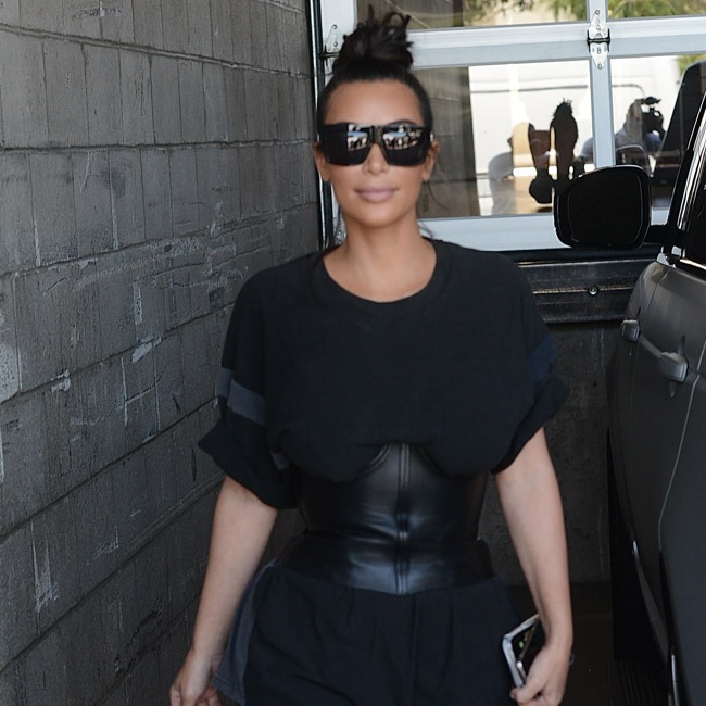 Kim Kardashian wears all black as she heads to studio ti film KUWTK in Los Angeles Pictured: Kim Kardashian Ref: SPL1321443 190716 Picture by: Aficionado Group / Splash News Splash News and Pictures Los Angeles:310-821-2666 New York: 212-619-2666 London: 870-934-2666 photodesk@splashnews.com