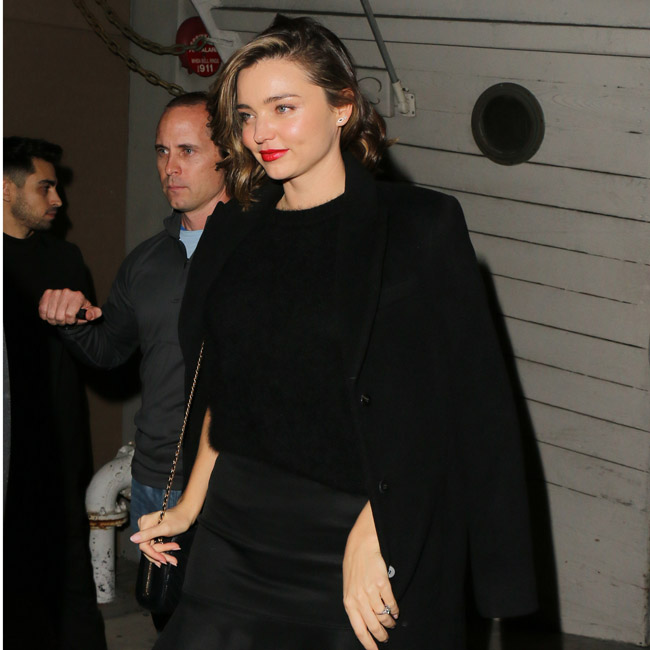 160314, Miranda Kerr and Fiance Evan Spiegel attend a Christmas Dinner Party at 'Giorgio Baldi' in Santa Monica. They then went to 'The Shore Bar' next door after dinner. They were surrounded by Heavily armed Body guards/security. Her Very Large Diamond engagement ring can be seen on her left hand. Los Angeles, California - Saturday December 17, 2016. Photograph: © MHD, PacificCoastNews. Los Angeles Office (PCN): +1 310.822.0419 UK Office (Photoshot): +44 (0) 20 7421 6000