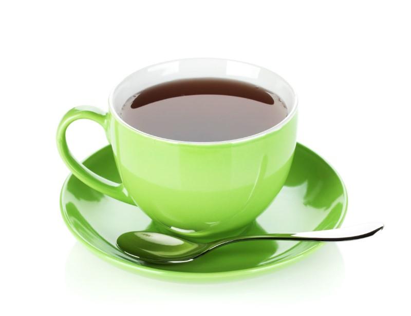 緑色のカップに入ったコーヒー