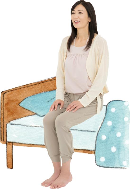 ベッドに座る中島史恵