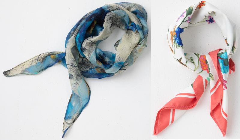 ブルー系のスカーフと白地にイラストが描かれて赤の太枠が入ったスカーフ