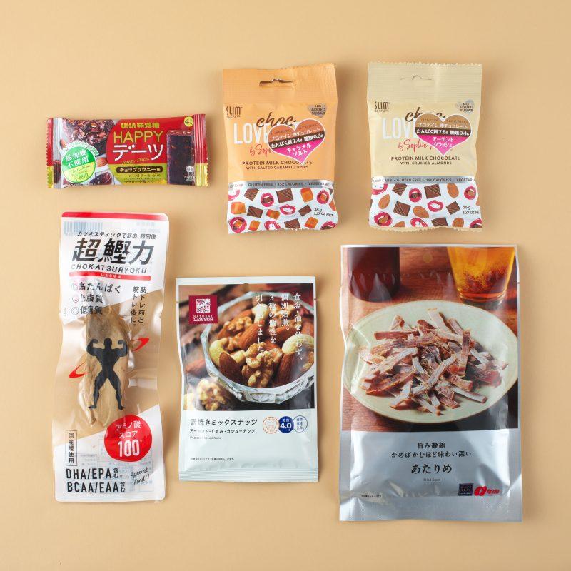吉永鰹節店の超鰹力 しょうゆ味とUHA味覚糖のHAPPYデーツ チョコブラウニーとスリムシークレット ラブバイツ(キャラメルソルト、アーモンドクラッシュとローソンのあたりめ 45gと素焼きミックスナッツ