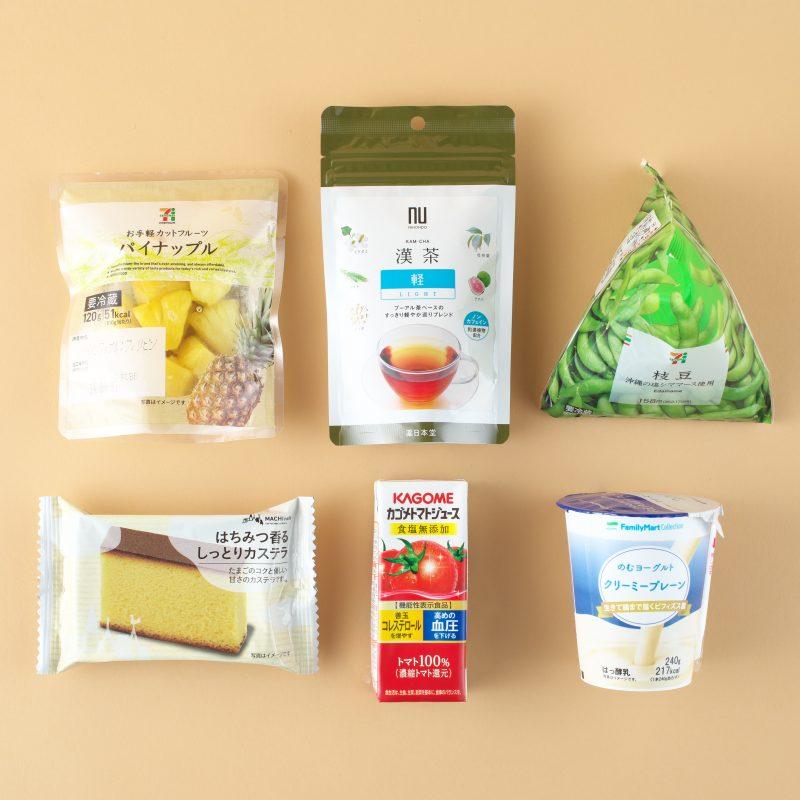 セブンイレブンの枝豆とパイナップルとファミリーマートののむヨーグルトと薬日本堂の漢茶(軽)とカゴメのトマトジュース食塩無添加200mlとセブンイレブンのひと切れカステラ