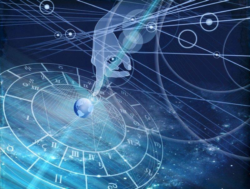 星空を背景にホロスコープと地球を指さす手のイメージ画像