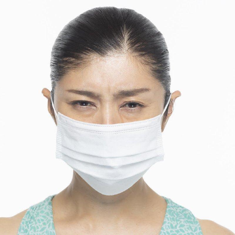 マスクを着けた間々田佳子さん