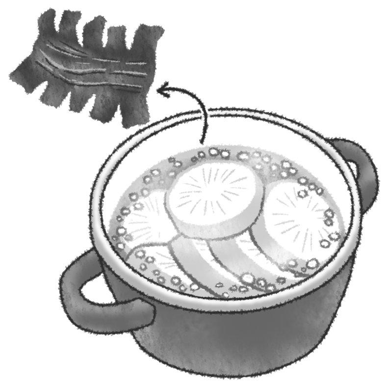 大根を煮ている鍋から昆布を取り出している