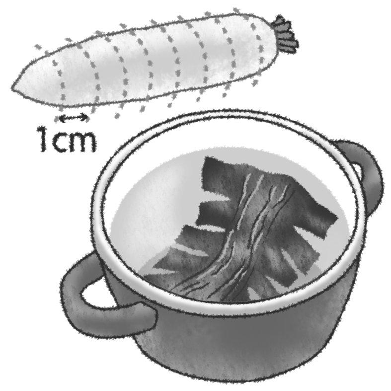 大根を1cmの輪切りにして、昆布の入った鍋に入れている