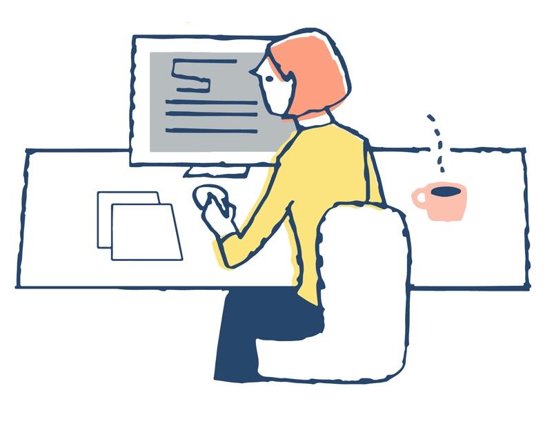 コーヒーを傍らに置きパソコンに向かう女性