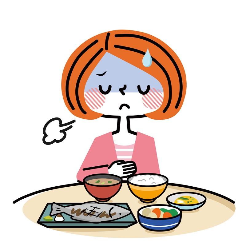 ご飯を前にする不調気味の女性