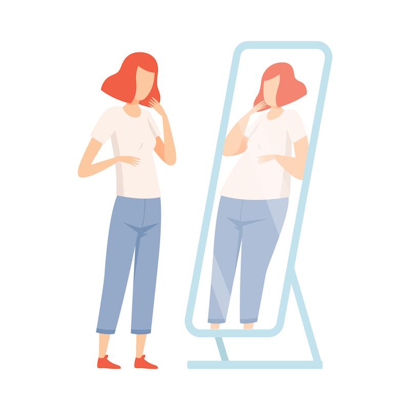 鏡の前に立つ女性のイラスト