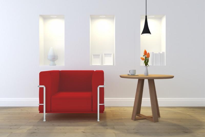 赤いソファーとサイドテーブルのある部屋